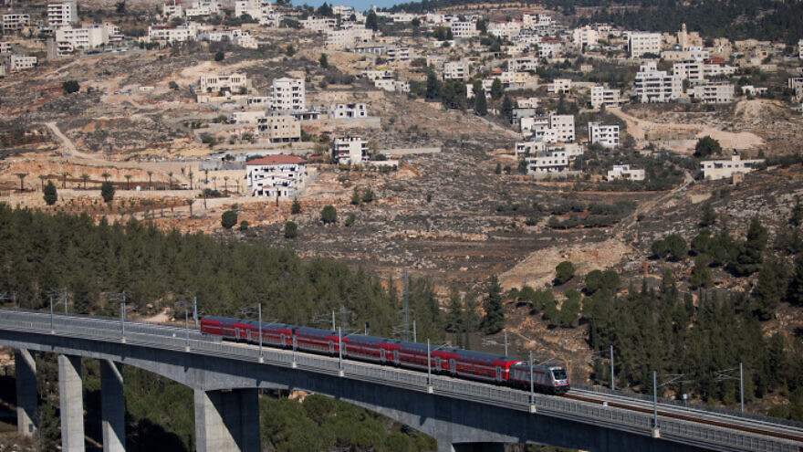 View of the new Tel Aviv-Jerusalem fast train over the Ha'arazim valley just outside of Jerusalem, Dec. 22, 2019. Photo by Yonatan Sindel/Flash90.