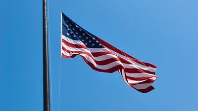 American flag flying at half-mast. Credit: Pixabay.