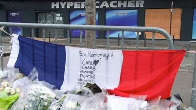 The French tri-colored flag outside the Hyper Cacher kosher market in Paris to pay homage to the four Jewish victims shot and killed inside the store a week earlier, Jan. 16, 2015. Credit: U.S. State Department Photo/Public Domain).