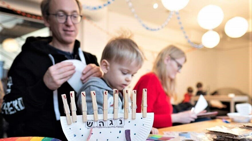 At JDC's flagship Warsaw JCC, young families club partake in a Hanukkah fair with a chance to build their own menorahs and compete in a dreidel contest, bringing new traditions to the burgeoning Jewish community in a country that was once home to millions of Jews before the Holocaust. Credit: Courtesy.