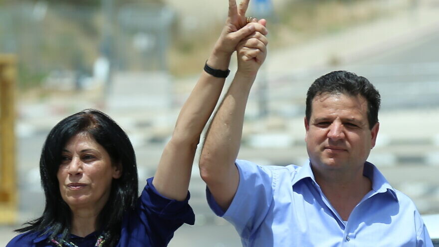 Khalida Jarrar (left), who was arrested by Israel's Shin Bet security service for her ties with the Popular Front for the Liberation of Palestinian (PFLP) terror group, is pictured with Israeli-Arab Knesset member Ayman Odeh, who heads the Joint Arab List. Credit: Wikimedia Commons.