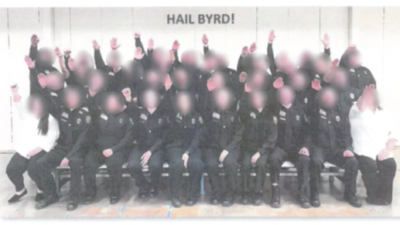 Several West Virginia corrections' workers have been suspended for performing a Nazi salute after a photo surfaced showing more than 30 students in a basic-training class doing so. Source: Screenshot.