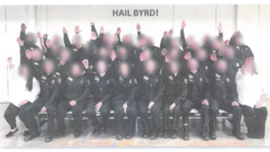 More than 30 West Virginia corrections' workers and cadets have been fired after a photo surfaced of them performing a Nazi salute. Source: Screenshot.