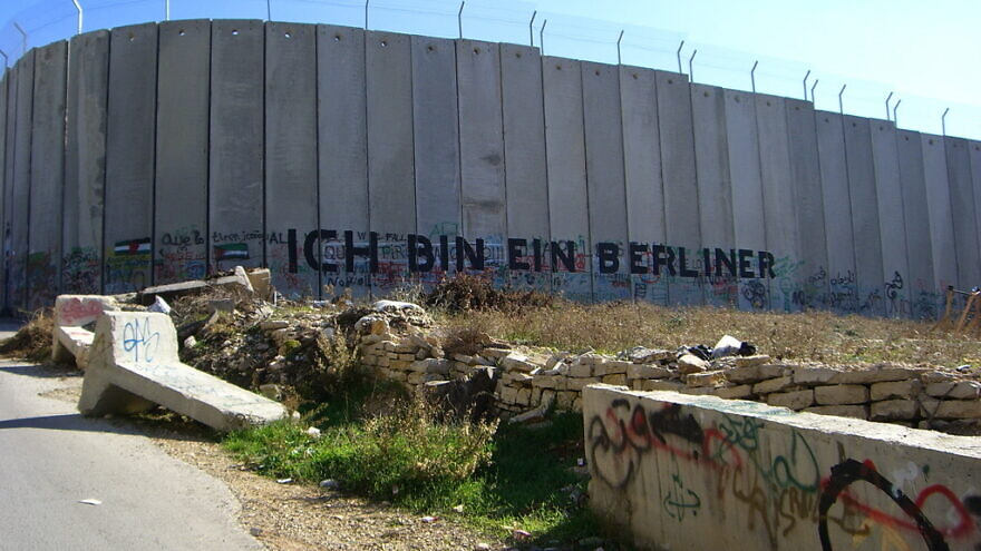 Graffiti on the security wall that separates Israel from the West Bank. Credit: Marc Venezia via Wikimedia Commons.