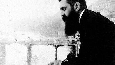 Theodor Herzl, considered the father of modern-day Zionism, leans over the balcony of the Hotel Les Trois Rois (Three King's Hotel/Hotel drei Könige) in Basel, Switzerland, possibly during the sixth Zionist conference there. Credit: The Bettman Archive.