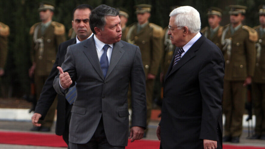 Palestinian Authority leader Mahmoud Abbas (right) and King Abdullah of Jordan walk together during a welcoming ceremony in the West Bank city of Ramallah, on Nov. 21, 2011. Photo by Issam Rimawi/Flash90.