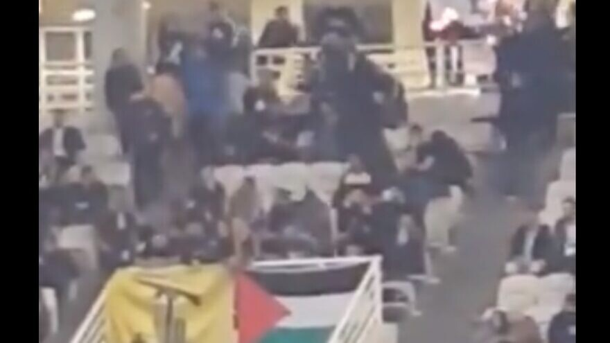 Fans of the Greek basketball team AEK Athens waved Hezbollah and Palestinian flags, and burned an Israeli flag during a game with the Israeli team Hapoel Jerusalem in Athens. Source: Screenshot.