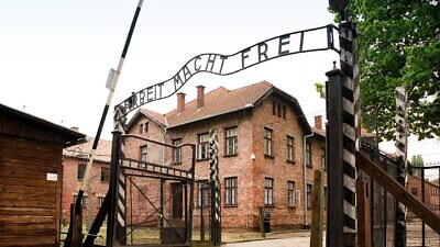 "The ""Arbeit Macht Frei"" gate at Auschwitz with the bitter irony of the German words: ""Work Will Set You Free."" Credit: Wikimedia Commons."