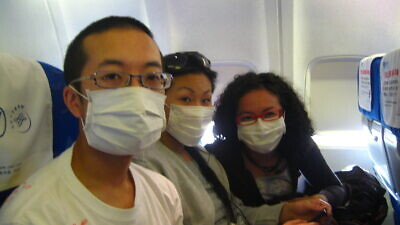 Chinese travelers wear masks as a precaution against infection. Credit: David Woo via Flickr.