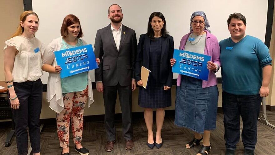 Michigan Democratic Jewish Caucus founder and chair Noah Arbit (far right) with supporters. Source: Michigan Democratic Jewish Caucus/Facebook.