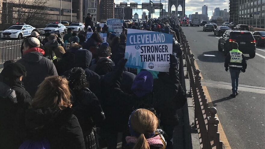 """A group from Cleveland walks across the Brooklyn Bridge at the """"No Hate. No Fear."""" rally in New York City that drew 25,000 people, Jan. 5, 2020. Credit: Jewish Federation of Cleveland."""