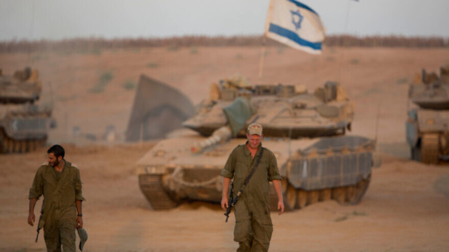 Israeli soldiers seen at a deployment area near the border with the Gaza Strip on Aug. 25, 2014. Photo by Yonatan Sindel/Flash90.