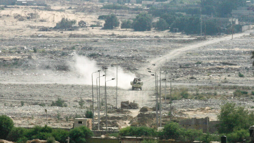 Egyptian armored vehicles patrol on the Egyptian side of the Gaza border, seen from the south of the Gaza Strip, on July 2, 2015. Photo by Abed Rahim Khatib /Flash90.