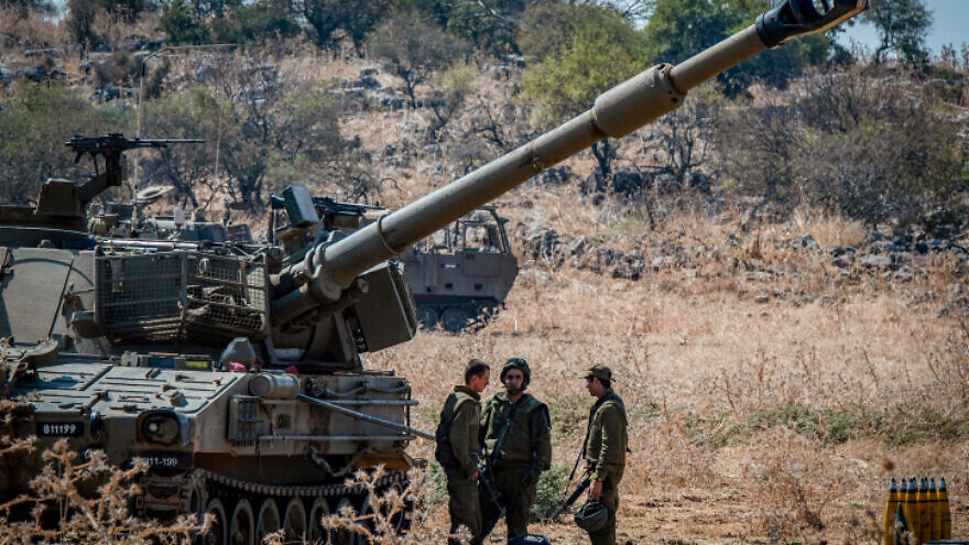 Israeli soldiers stand near artillery units near the Lebanese border outside Kiryat Shmona in northern Israel, on Sept. 1, 2019. Photo by Basel Awidat/Flash90.