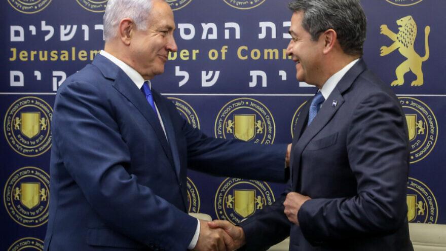 Israeli Prime Minister Benjamin Netanyahu and President of Honduras Juan Orlando Hernández shake hands at the opening of a Honduran Trade Office in Jerusalem, on Sept. 1, 2019. Photo by Marc Israel Sellem/POOL.