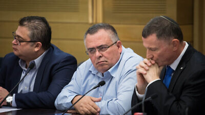 Likud member David Bitan (center) attends the first election committee meeting at the Knesset in Jerusalem, on Dec. 18, 2019. Photo by Hadas Parush/Flash90.