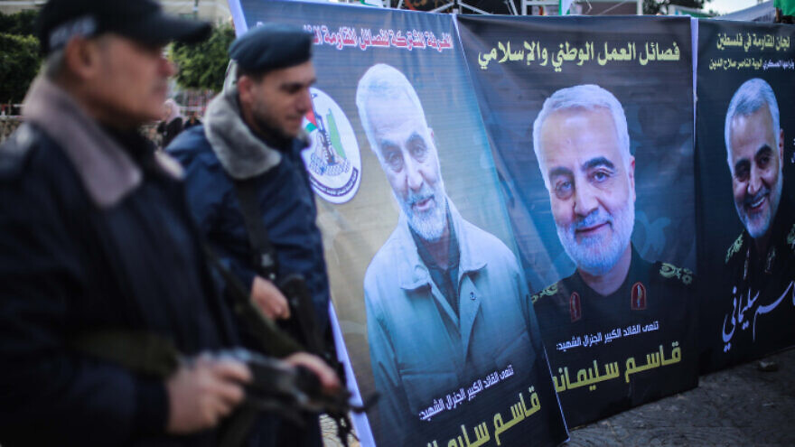 Palestinians walk next to posters of Qassem Soleimani, who was killed in a U.S. drone strike in Iraq on Jan. 3, near a mourning tent in Gaza City on Jan. 4, 2020. Photo by Hassan Jedi/Flash90.