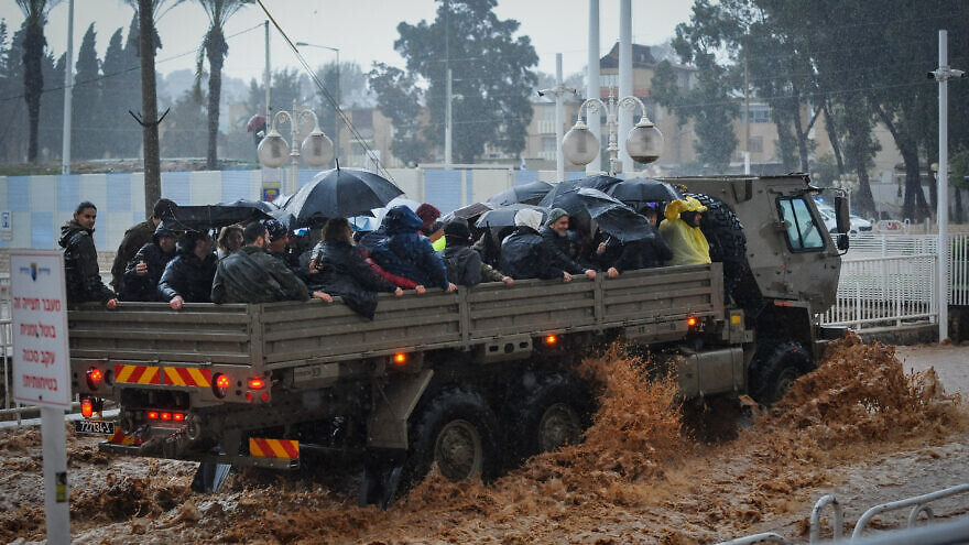 A military truck evacuates Israeli citizens through a flooded road in the northern Israeli city of Nahariya on Jan. 8, 2020. Photo by Meir Vaknin/Flash90.