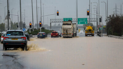 Cars drive on flooded road at Ad-Halom Junction following a heavy rainfall near the southern Israeli city of Ashdod on Jan. 9, 2020. Photo by Flash90.