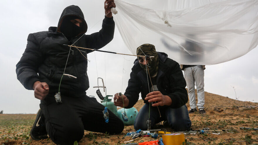 Palestinians prepare an incendiary device to be launched near the Israel-Gaza border in the southern Gaza Strip, on Jan. 18, 2020. Photo by Abed Rahim Khatib/Flash90.