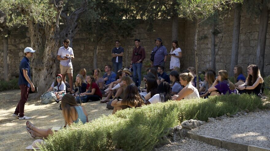 Young Americans visit the Garden of Gethsemane in Jerusalem as part of a nine-day trip to Israel organized by Passages, a Christian nonprofit that offers Christian college students with leadership potential an innovative approach to experiencing Israel. Credit: Courtesy.