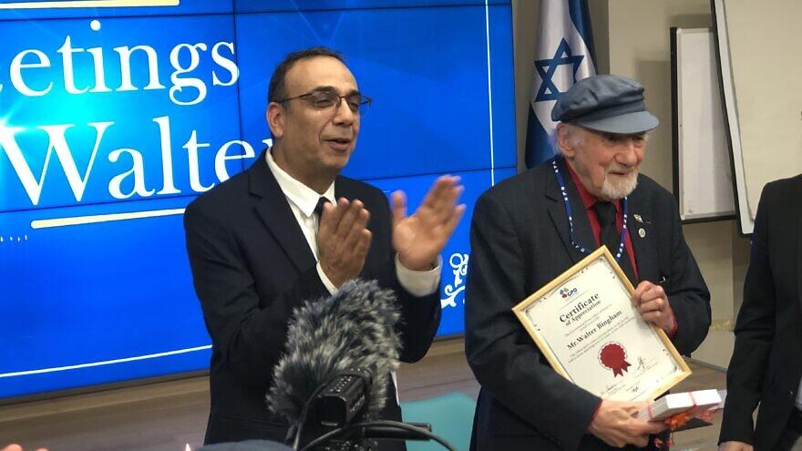 Government Press Office director Nitzan Chen and 95-year-old Walter Bingham, December 2019. Photo by Judy Lash Balint.