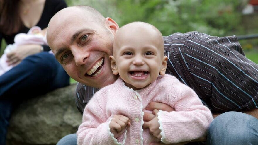 Oded Grinstein and his daughter, Shani, who was diagnosed with a very rare and aggressive type of sarcoma at 9 months old. He has since gone to to found MyChild'sCancer (MCC) in 2010. Credit: Courtesy.