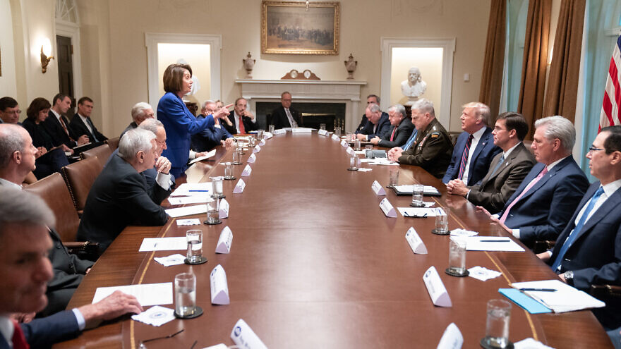 Speaker of the House Nancy Pelosi addresses President Donald Trump in the cabinet room at the White House in October 2019. Source: Wikimedia Commons.