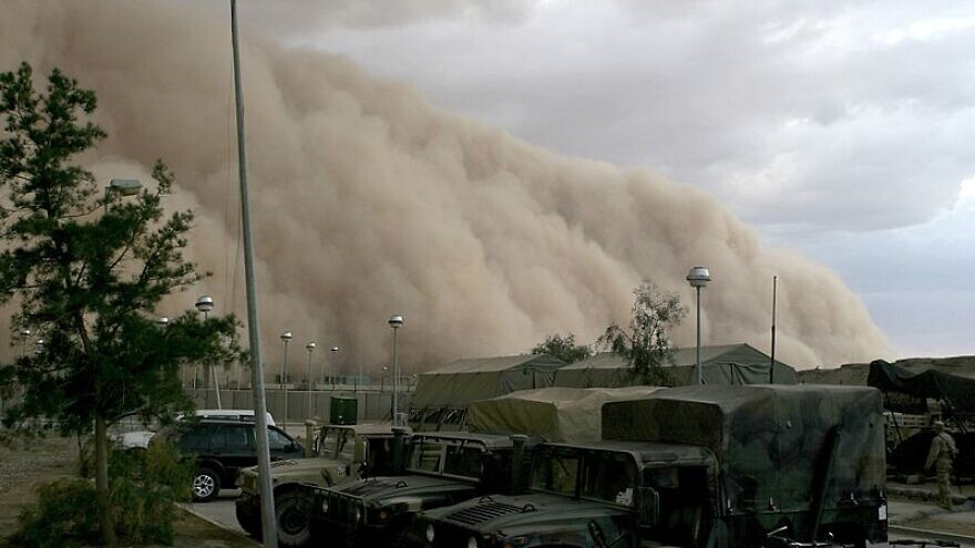A massive dust storm cloud is close to enveloping a military camp as it rolls over Al Asad, Iraq, just before nightfall on April 27, 2005. Credit: Corporal Alicia M. Garcia/U.S. Marine Corps.