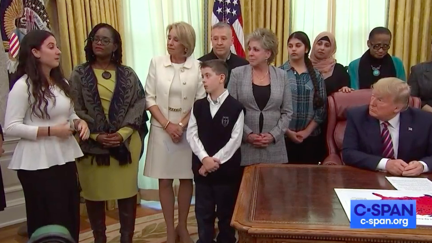 Ariana Hoblin, a Jewish public-school student from Florida, tells U.S. President Donald Trump about being bullied in middle school for her religion. It took place during a ceremony in the Oval Office when Trump signed an executive order to better protect prayer in public schools and federal funds for religious organizations on Jan. 16, 2020. Source: Screenshot.