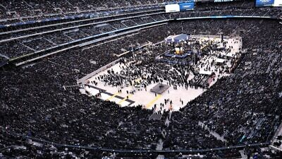 "View of the crowd at the 13th ""Siyum Hashas"" of Daf Yomi at MetLife Stadium in New Jersey, Jan. 1, 2020. Photo by Moshe Gershbaum and Chaim Schwartz/Agudath Israel of America Archives."