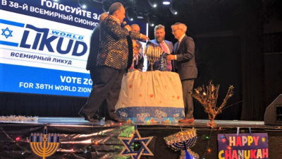 Russian-speaking division leaders Vlad Lipkin and Ben Kogan light the Hanukkah menorah  in front of 1,300 supporters at Master Theater in Brighton Beach, N.Y., on Dec. 26, 2019. Photo by Helen Kogan.