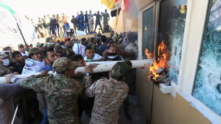 Under the orders of Iran's Islamic Republican Guards Corps, pro-Iranian militias in Iraq led mob attacks on the U.S. embassy in Baghdad on Dec. 31, 2019. Source: Screenshot.