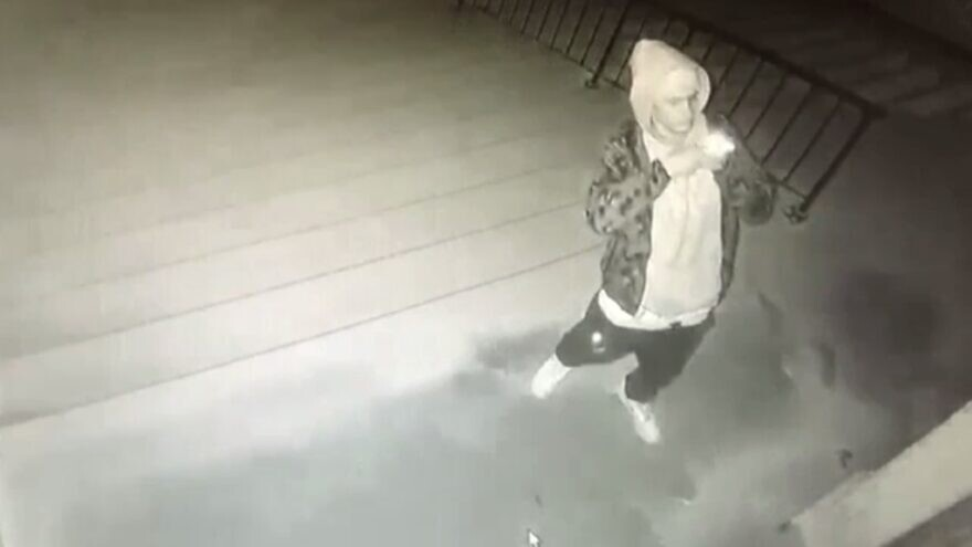 Police are searching for a suspect who vandalized the South Street Temple in Lincoln, Neb., with a racial slur and swastika. Source: Screenshot.