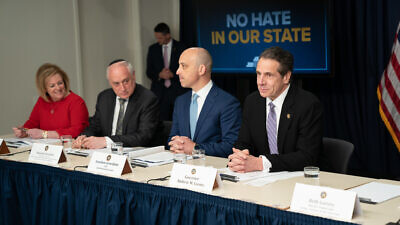 "New York Gov. Andrew Cuomo (right) launches the ""No Hate in Our State"" campaign to combat crimes, divisiveness and anti-Semitism in New York State. Seated to his left is ADL CEO and national director Jonathan Greenblatt, Malcolm Hoenlein executive vice chairman of the Conference of Presidents of Major American Jewish Organizations, and Cheryl Fishbein, president of the Jewish Community Relations Council of New York. Credit: New York Governor's Office via Flickr."