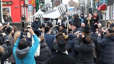 Celebrants dance down the streets of Reykjavik, the capital of Iceland, to mark the completion and inauguration of a Torah scroll on the European island. Photo by Gabriel Rutenberg/Chabad.org/News.