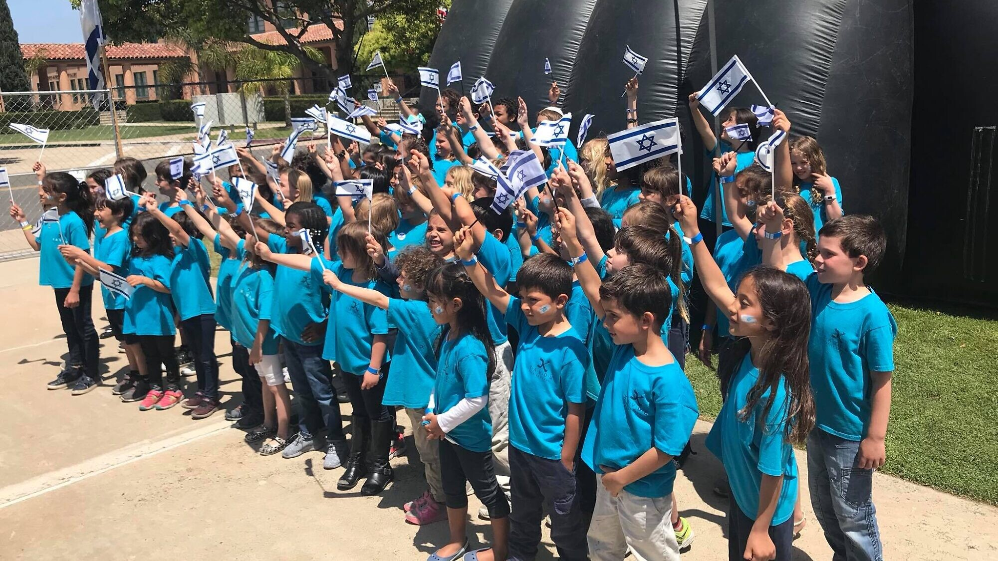 Children at the Kavod Charter School in San Diego. While math, reading and writing are taught in English, much of the rest of the school day—from morning meeting to art class to physical education and even recess are conducted in Hebrew. Source: Kavod Charter School via Twitter.