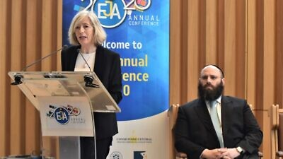 UNESCO assistant director-general Stefania Giannini speaks at the European Jewish Association's (EJA) annual policy conference in Paris; seated is EJA chairman Rabbi Menachem Margolin, Feb. 24, 2020. Photo by Yoni Rykner.