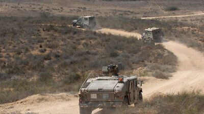 Israeli armored vehicles patrol near the Israel-Gaza border, on Aug. 20, 2011. Photo by Gili Yaari/Flash 90.