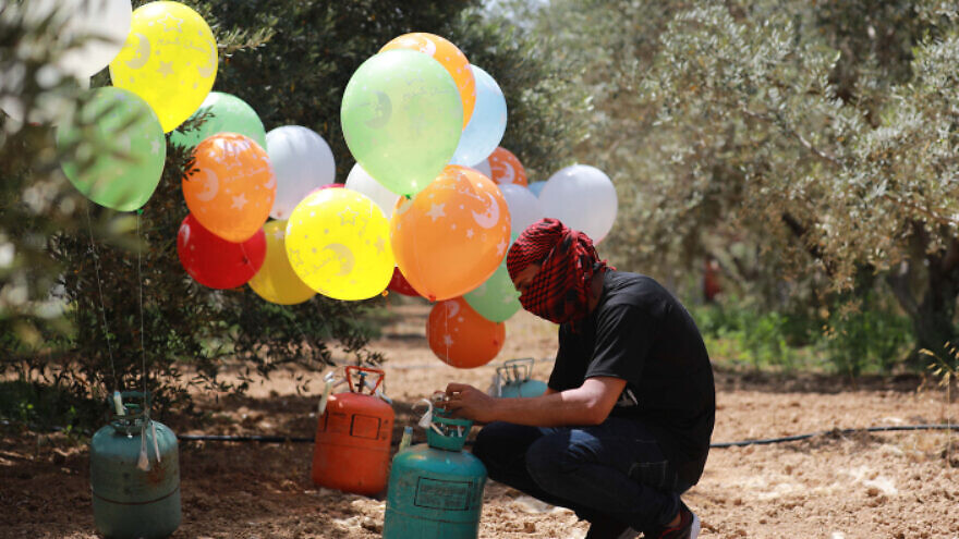 Palestinians in the Gaza Strip prepare explosive devices to be launched into Israel, on May 31, 2019. Photo by Hassan Jedi/Flash90.