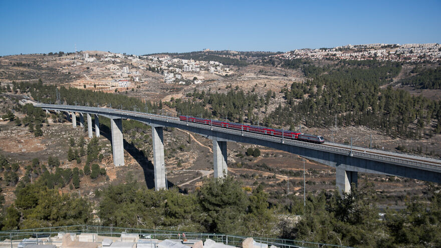 "View of the new Tel Aviv-Jerusalem high-speed train seen over the HaArazim Valley (""Valley of Cedars"") just outside of Jerusalem, Dec. 22, 2019. Photo by Yonatan Sindel/Flash90."