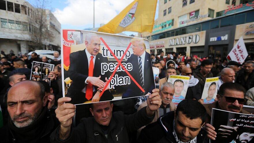 Palestinian demonstrators protest against U.S. President Donald Trump's Mideast peace plan in Hebron on Jan. 30, 2020. Photo by Wisam Hashlamoun/Flash90.