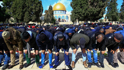Muslims perform Friday prayers at the Al Aqsa mosque compound, in Jerusalem's Old City, on Jan. 31, 2020. Photo by Sliman Khader/Flash90.