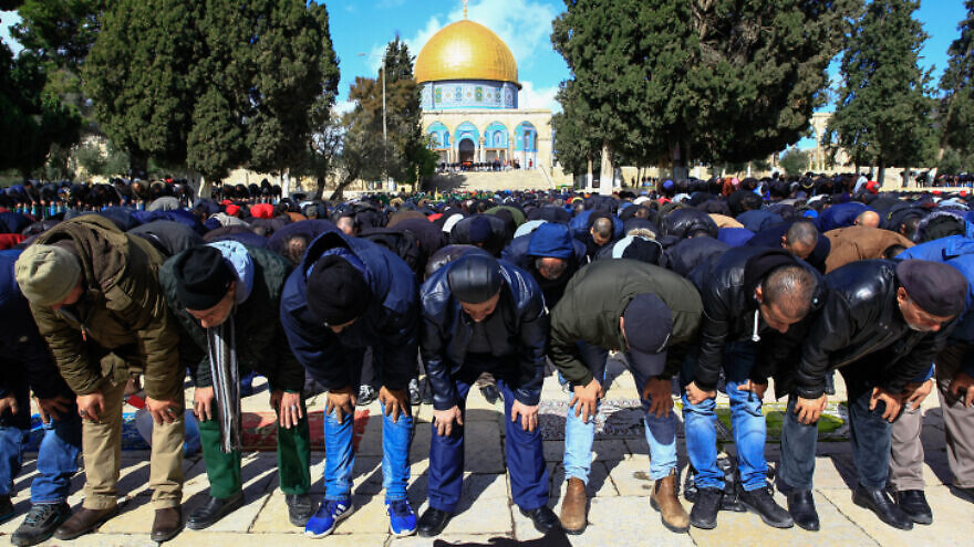 Muslims perform Friday prayers at the Al-Aqsa mosque compound in Jerusalem's Old City on Jan. 31, 2020. Photo by Sliman Khader/Flash90.