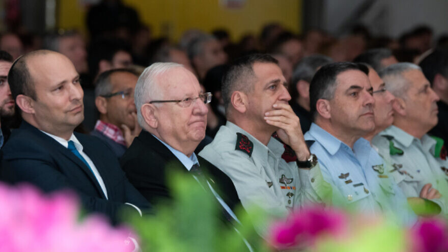 From left: Israeli Defense Minister Naftali Bennett, President Reuven Rivlin and IDF Chief of Staff Lt. Gen. Aviv Kochavi attend a ceremony in northern Israel marking the 23rd anniversary of the 1997 Israeli helicopter disaster, in which 73 IDF soldiers died, Feb. 11, 2020. Photo by Basel Awidat/Flash90.