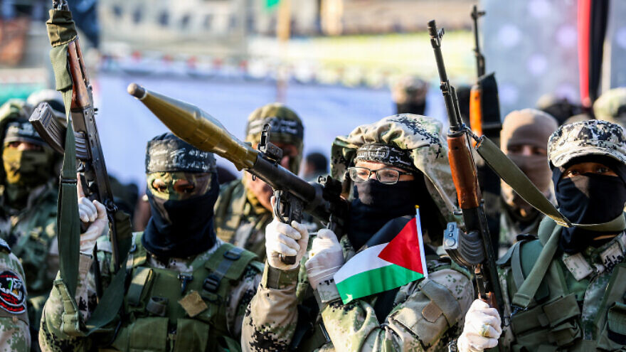 Palestinian terrorists participate in an anti-Israel rally in Khan Yunis in the southern Gaza Strip, on Feb. 17, 2020. Photo by Abed Rahim Khatib/Flash90.