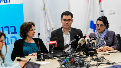 Israeli Health Ministry director-general Moshe Bar Siman Tov (center) and professor Siegal Sadetzki (right) hold a press conference in Tel Aviv about the coronavirus, Feb. 24, 2020. Photo by Avshalom Sassoni/Flash90.
