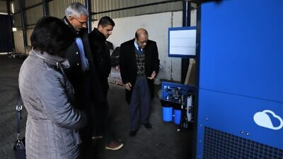 Examining the GEN-M water machine in the Gazan neighborhood of Abasan al-Kabira, Feb. 12, 2020. Credit: Damour for Community Development.