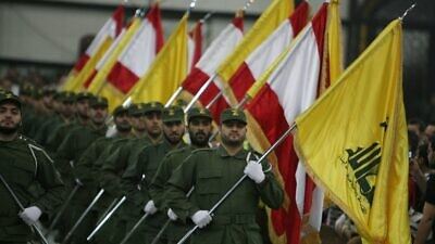 Hezbollah fighters march in a ceremony. Credit: Wikimedia Commons.