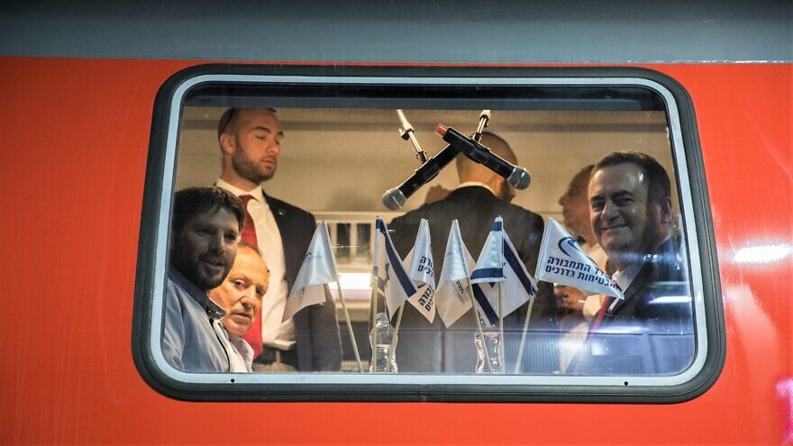 Transportation Minister Bezalel Smotrich on the first ride of the the new high-speed train between Jerusalem and Tel Aviv on Dec. 18, 2019. To help tourists and east local traffic congestion, he announced its future extension to the Old City, February 2020. Photo by Yonatan Sindel/Flash90.